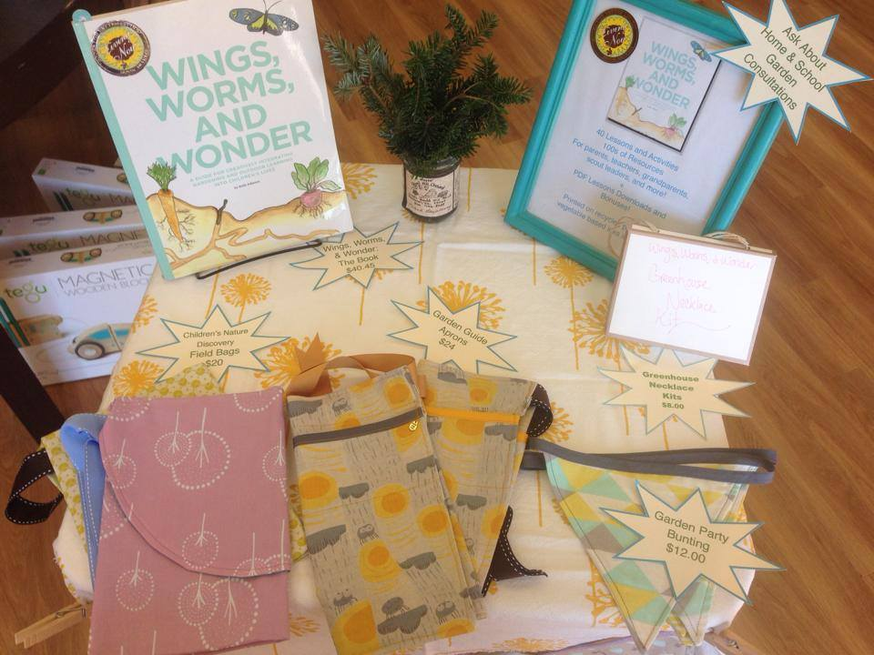 book table with aprons and bags